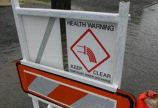 Temporary health warning sign.