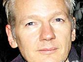 BRITISH intelligence agency GCHQ has asked staff to behave more professionally after Julian Assange obtained internal e-mails saying he may have been framed.