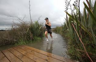 Emma Gyenge got her feet wet when she encountered a king tide yesterday on Waikareao Estuary's boardwalk and walkway.