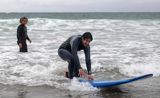 Surfing instructor Laura Rishworth gives Ohauiti teen Rupert Gyton, 17, a few tips.