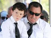 Danny McGuire with his son Zachary Jibson at the funeral yesterday of Llync-Chiann Clark-Jibson, Jocelyn and Garry Jibson.