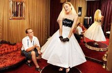 No bridezillas: Lismore Bridal owner Micheal Gates watches store assistant Emily Sexton model the latest 1950s-style new season bridal design.