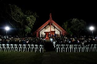 Solemn: Crowds gather at the Waitangi Te Whare Runanga Marae for the 5am dawn service last year.