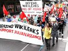 WORK PRAISED: Protesters hold a rally in support of Julian Assange outside Town Hall in the Sydney CBD.