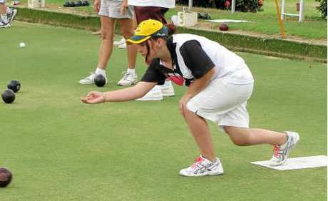 Tiffany Murray's bowl takes right line down the green.