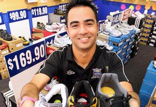 IF THE SHOES FIT ... Hawke's Bay United defensive midfielder Marvin Eakins combines his passion for the beautiful game with a full-time role at Smiths Sports Shoes in Napier.