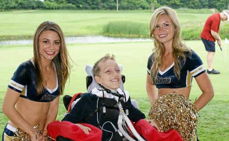 sports fan alex malarkey with cheerleaders from the st louis rams one