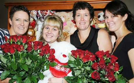 BUSINESS IS A blooming at Gatton Florist on Valentines Day, as Lisa Spierling, Rianna Krenske, Kylie le Gonidec and Niah Spierling work overtime to cope with demand and help spread the romance.