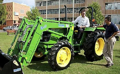 Mayor Peter Taylor (left) accepts the keys to a new John Deere tractor from Vanderfield Toowoomba manager Jason Jones.