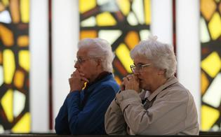 Parishioners pray as Christchurch Bishop Barry Jones celebrates Mass at Our Lady of Victories Catholic Church yesterday.