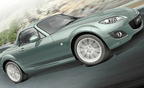 The Mazda MX5 Roadster Coupe's direct response steering allows the car to soar.