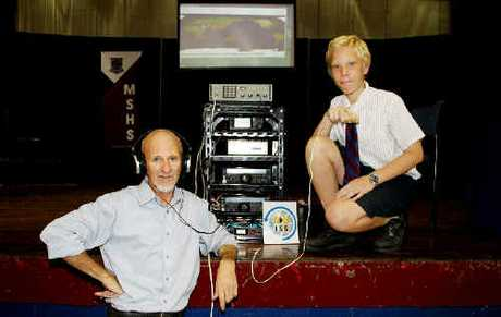 ARISS operation ground station officer Shane Lynd and Mackay State High School student Aaron Glanville prepare to talk to NASA astronaut Paolo Nespoli in space yesterday.