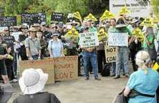Hundreds of protestors call on the state government to put a stop to mining exploration permits at a Community Cabinet Meeting.