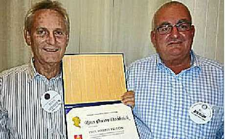 Gympie Rotary Club member Ross Dobbrick (left) has been awarded Rotary's highest award, a Paul Harris Fellowship. He is pictured with his award proposer Paul Atkinson.
