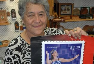 Kerewai Wanakore proudly shows the poster depicting her granddaughter, Tineka Wanakore-Eruera, on the newly released $1.20 stamp.