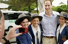 Prince William during his visit at West Moreton Anglican College with students (from left) Natasha Holt, Breanna Cunniffe, Madeline Spann, and Alexander Clark. Photo: David Nielsen