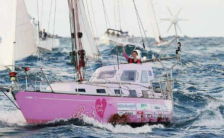 Teen sailor Jessica Watson sails into Sydney Harbour and into history aboard her yacht, Ella's Pink Lady.