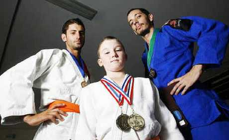 Ipswich Central Judo Club martial artists (from left) Luke Maczyszyn, Logan Spark and Sam Landy recently won state medals in Brazilian jiu-jitsu.