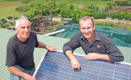 John Jessup (left) from Lismore Community Garden and Nick Lake from Nickle Energy like the feel of solar power.