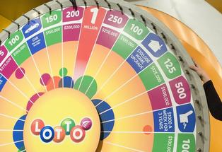 WINNING WHEEL: Liz, of Havelock North, spins to win $200,000 on Saturday night's live Lotto draw.