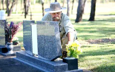 Lending a hand at Mount Bassett Cemetery, Paul Sologinkin has found upkeep of the cemetery has been very difficult due to the prolonged rainy conditions.