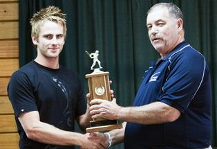 Kane Williamson receiving the Bay of Plenty Cricket Association 'Player of the Year' trophy from chairman Chris Rapson.