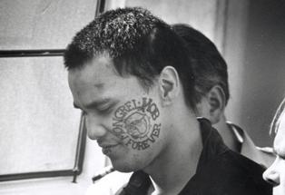 RELEASE: John Gillies had his face tattoo removed while in prison.