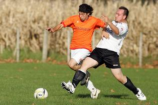 AFC Fury's Nicolas Storace (left) fights for possession with Whakatane Town's Shem Clark. Fury won 5-2 at Te Puna.