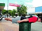 Nick Powell planking on a rubbish bin in Mary Street Gympie Renee Pilcher.