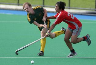 Mt Maunganui's Lachie Murgrave, left, battles with Aces' Connor Herewini in their Intercity Division One men's hockey match. Aces won the match 5-3.