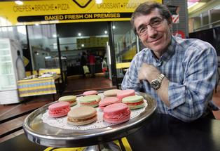 Yellow Place - French Cafe owner Fred Wasem with his homemade macarons.