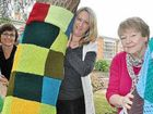 Loretta Grayson, Karina Devine and Pat Benkendorff prepare the art gallery tree for yarn bombing day tomorrow.