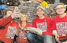 Celebrating their success in creating the world's biggest lamington are (from left) Geoff McDonald, Julie Lancaster-Smith, Julian Lancaster-Smith and Brad Smith.