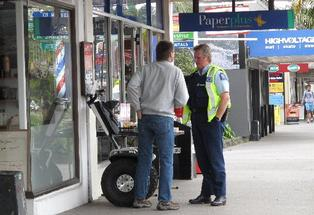 Stand-off: Kaikohe Hotel owner Neal Summers is pulled over by police for riding his Segway on a Kerikeri footpath.