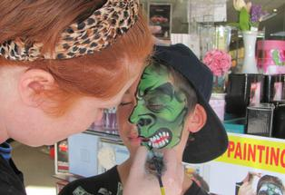 ART: Special effects make up expert Hayley Marlow, from Weta Workshops, puts final touches on the comical face creation at Amcal Pharmacy, Hastings.
