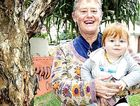 Yaroomba resident Wendy Gordon and grandson Avishai celebrate the survival of the 60-year-old melaleuca trees.