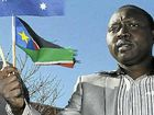 Waving flags in celebration of South Sudan's independence is Elijah Kuir Choll.