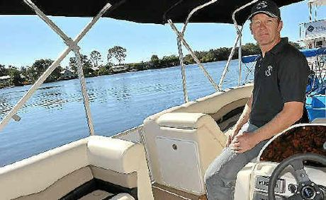Jo Van Os with the electic pontoon he is hiring on the Noosa River.