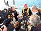 A media scrum meets boat owner John Verwoerdt, who was on a jet ski with two passengers at the time of the fire.