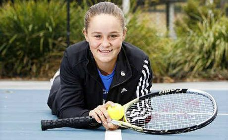Junior Womens Wimbledon champion Ashleigh Barty lies on the Springfield Lakes Tennis Court now named after her to honour her recent victory.