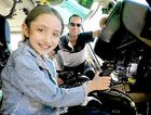 Seven-year-old Briar-Rose Harder with Westpac Rescue Helicopter Service pilot Tom Hulse.