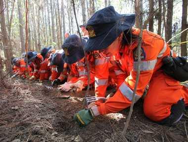 SES comb through the bushland looking for the remains of Daniel Morcombe.  FILE IMAGE