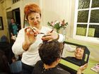 Flood victim Cheryl Ryan from Karalee enjoys a free hair cut courtesy of a pampering event hosted by the National Council of Women.