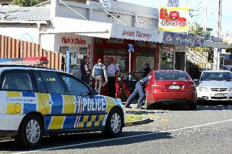 Police at the scene of the robbery at Arataki Superette.