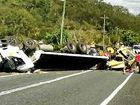 ROLLOVER: The driver involved in this truck rollover had minor injuries but the crash blocked Shute Harbour Rd at Airlie Beach for about four hours yesterday. A steam roller the truck was carrying left the road damaged.