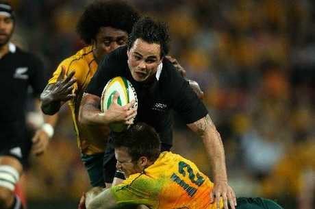 Zac Guildford of the All Blacks is tackled by Pat McCabe and Radike Samo of the Wallabies during the Tri-Nations Bledisloe Cup match between the Australian Wallabies and the New Zealand All Blacks at Suncorp Stadium on August 27, 2011 in Brisbane. Photo by Phil Walter/Getty Images