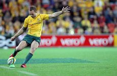 Quade Cooper kicks for goal.