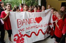 WOOMBYE State School students show their support for Daniel Morcombe during a visit to the school by Daniel&#39;s parents Bruce and Denise Morcombe.