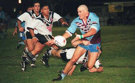 A Central Capras player offloads during a game from yesteryear.