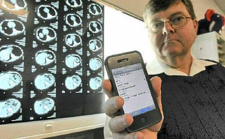 Bundaberg Medical Imaging chief radiographer Greg Menzies with the new iPhone application that allows doctors to access medical scans and information.